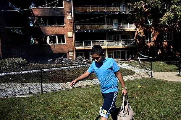 A boy carries a bag past burnt out apartment building after an a boy carries a bag past burnt out apartment building after an explosion at flower branch mightylinksfo