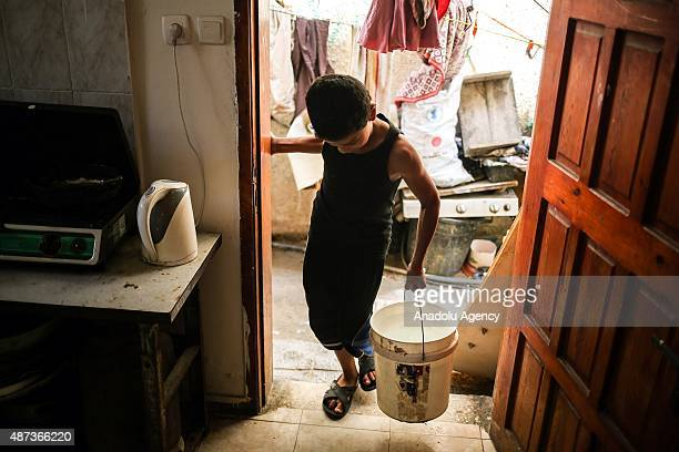 Boy carries a water bucket in Gaza City, Gaza on September 9, 2015. At least 120,000 Palestinians face water crisis just because infrastructure...