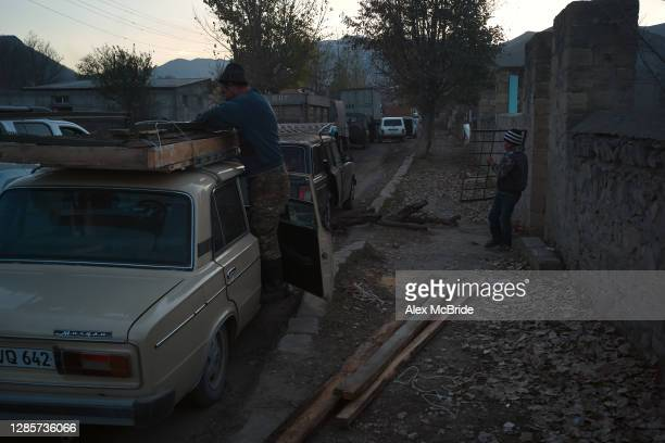 Boy carries his family's property out of their home as Armenians flee the territories in Nagorno-Karabakh that will be handed over to Azerbaijan by...