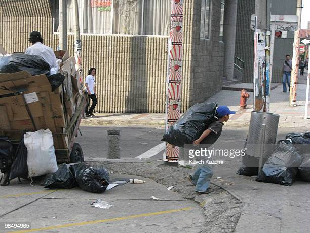 A boy carries material collected from garbage put in a bag for recycling in the old part of the city Bogota formerly called Santa Fe de Bogota is the...