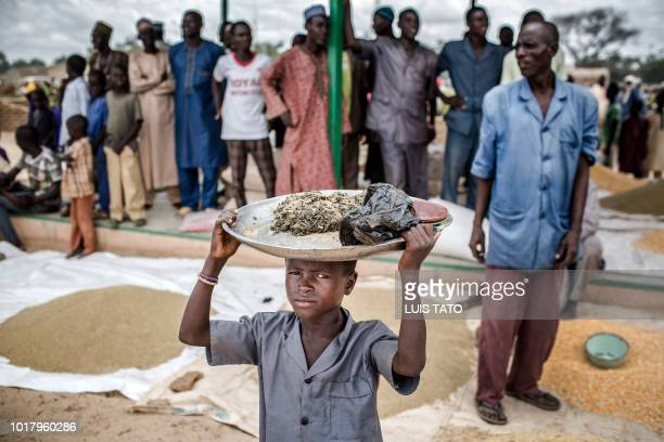 A boy carries some goods on his head in a local market upon the arrival of a United Nations convoy in the village of Sabon Machi Maradi region Niger...