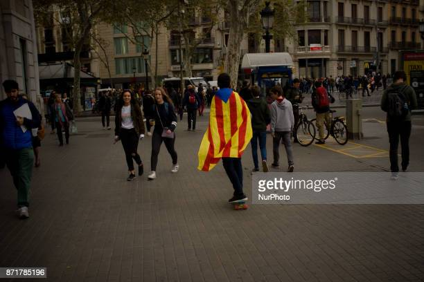 A boy carrying a estelada or proindependence flag skates by the streets of Barcelona Spain on 8 November 2017 Catalonian territory went on general...