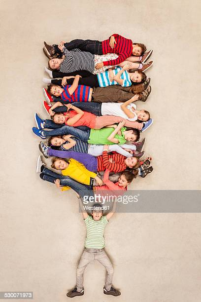 Boy carrying all his friends piled up