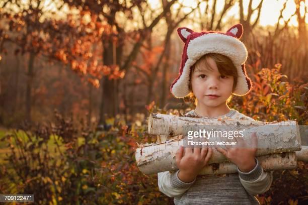 Boy carrying firewood