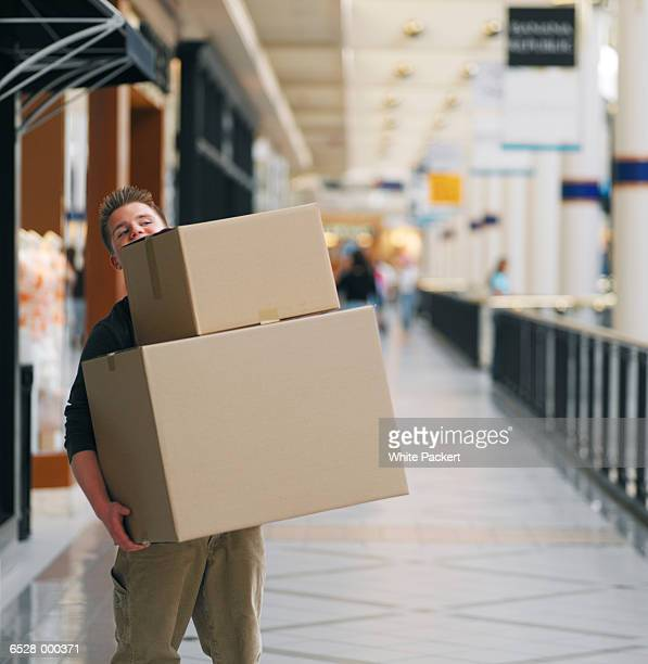 Boy Carrying Large Boxes