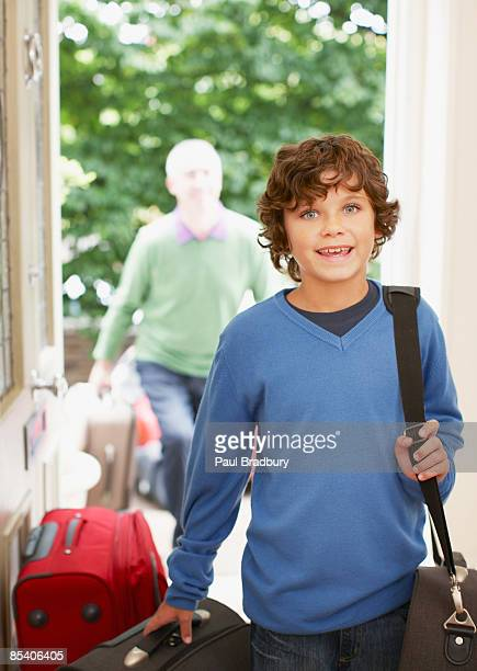 Boy carrying luggage