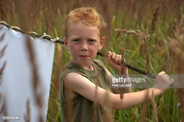 Boy Carrying White Flag