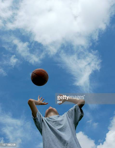 boy catching basketball (2) - catching stock pictures, royalty-free photos & images