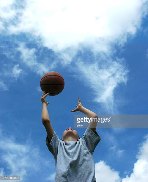 Boy Catching Basketball