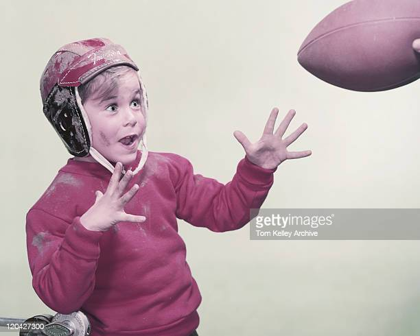 boy catching rugby ball  - 1957 stock pictures, royalty-free photos & images