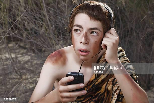 Boy Caveman Wearing Headphones with Music Player