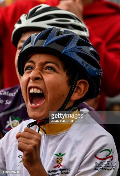 A boy celebrates as he watches the Tour de France in Zipaquira Colombian cyclist Egan Bernal's hometown Cundinamarca Colombia on July 27 2019 On...
