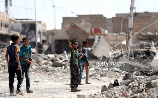 A boy celebrates Iraqi force's victory on the street on July 11 2017 in Mosul Iraq Iraqi Prime Minister Haider alAbadi declared the victory over the...