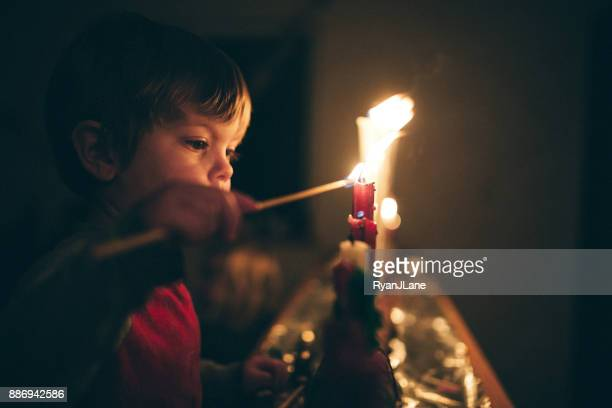 boy celebrating advent holiday with candles - candle stock pictures, royalty-free photos & images