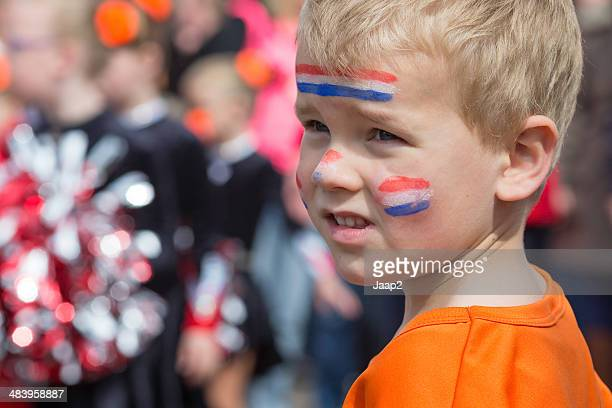 boy celebrating dutch queen's day - king's day netherlands stock pictures, royalty-free photos & images