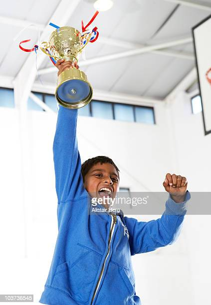 boy celebrating in gymnasium - newhealth stock pictures, royalty-free photos & images