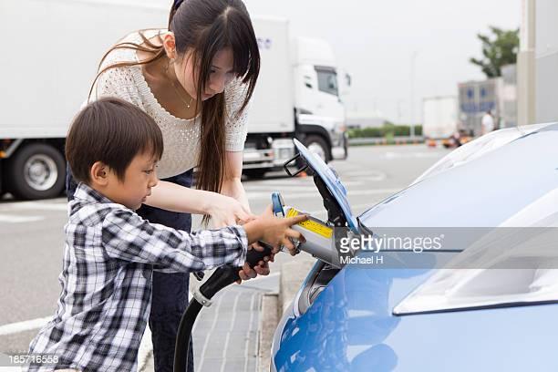 boy charging Electric Car