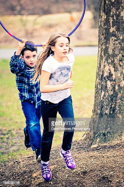 boy chases girl - mclean virginia stock pictures, royalty-free photos & images
