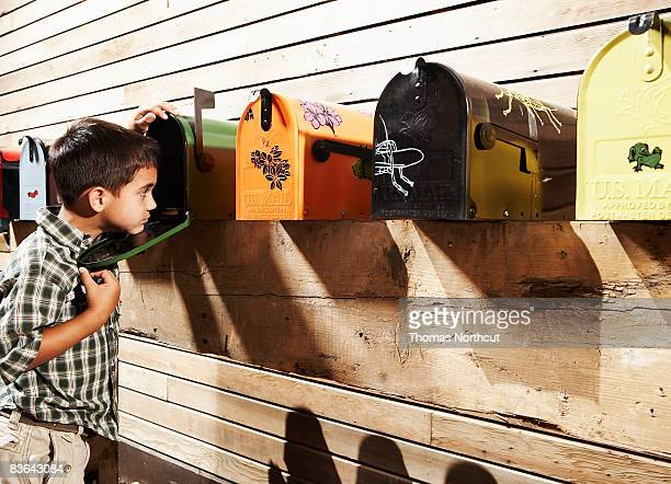 boy checking for mail