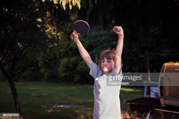 Boy cheering at game of table tennis