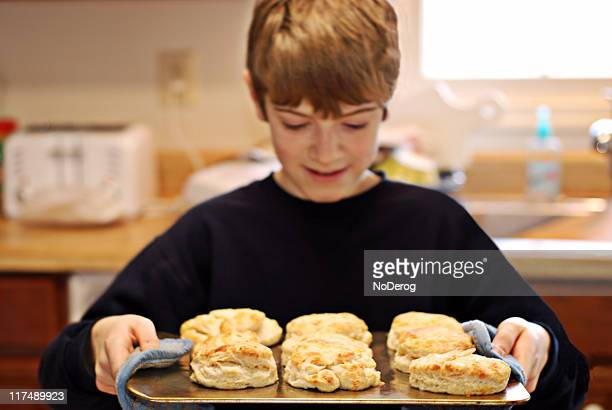 Boy chef with tray of biscuits