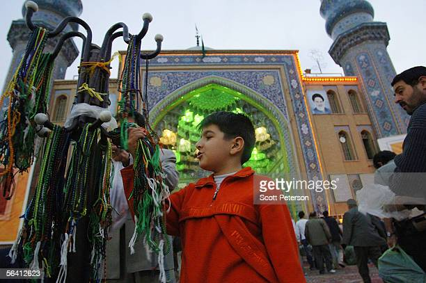 A boy chooses a string of prayer beads outside the Jamkaran Mosque December 6 2005 in Jamkaran Iran Some Iranian Shiites believe and are waiting for...