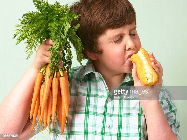 Boy choosing junk food over vegetable