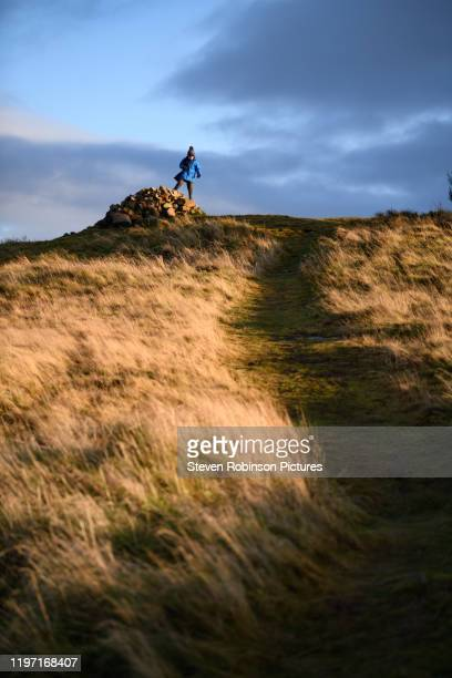 boy climbing hill, winter - perth scotland stock pictures, royalty-free photos & images