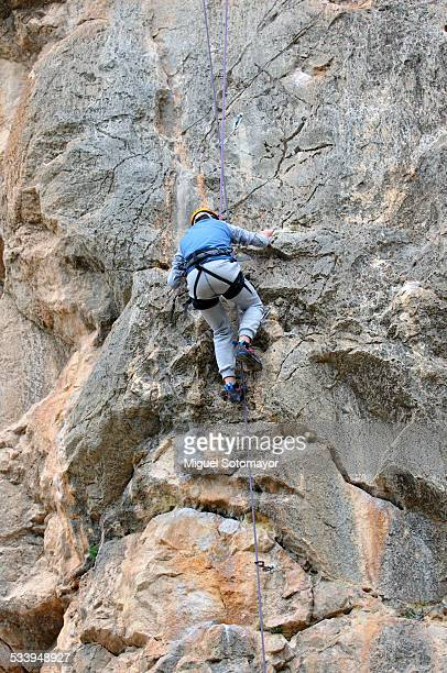 Boy climbing in rock