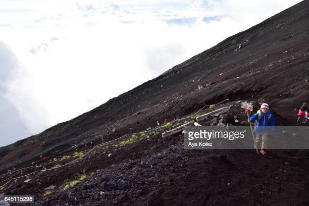 Boy climbing Mt.Fuji