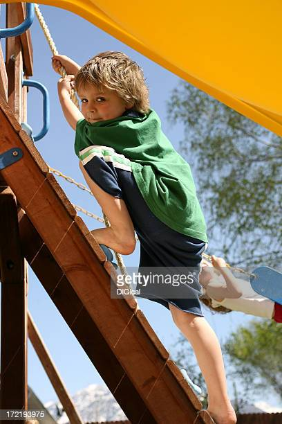 Boy Climbing On A Rock Wall