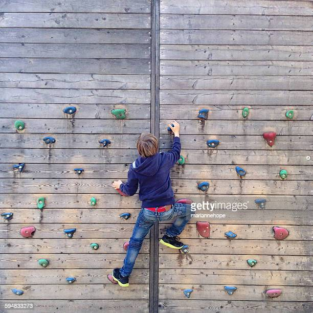 Boy climbing on climbing wall