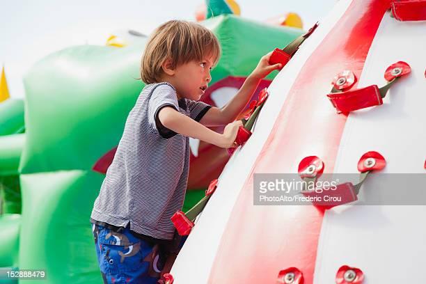 Boy climbing on playground