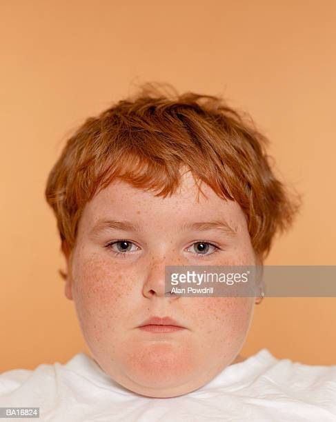 boy (10-12), close-up, studio portrait - chubby boy stock photos and pictures