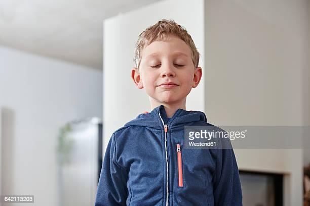 Boy closing his eyes