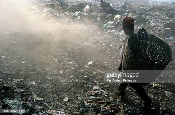 Boy collecting garbage at Stung Meanchey dump in Phnom Penh, Cambodia