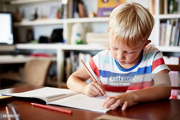 Boy coloring at table