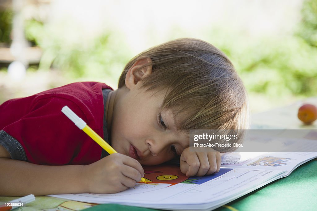 Boy Coloring With Markers Stock Photo | Getty Images