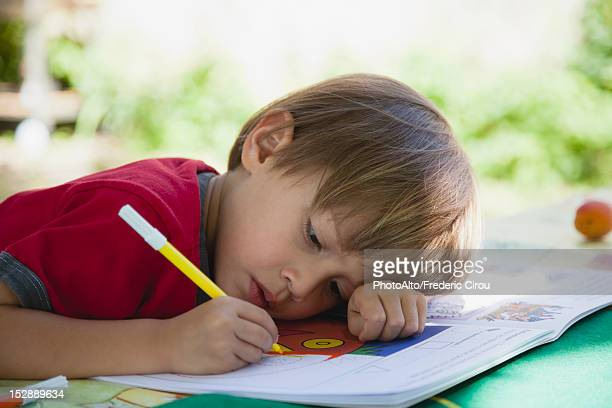 boy coloring with markers - colouring book stock photos and pictures
