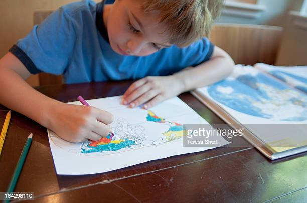 boy coloring world map - colouring stock pictures, royalty-free photos & images