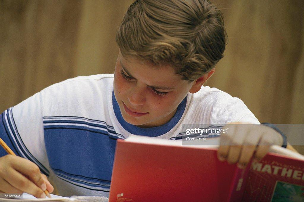 Boy concentrating on math homework : Stockfoto