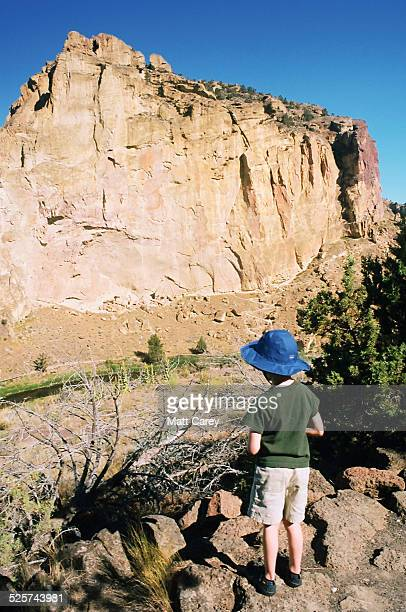 boy contemplating desert - smith rock state park stock pictures, royalty-free photos & images