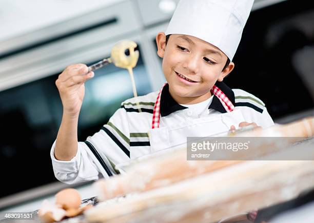 Boy cooking dinner