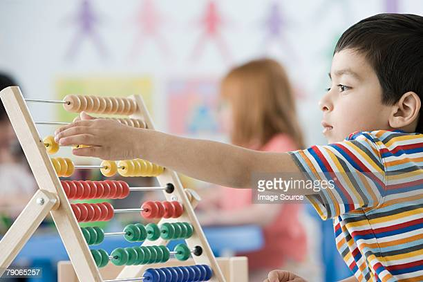A boy counting on abacus