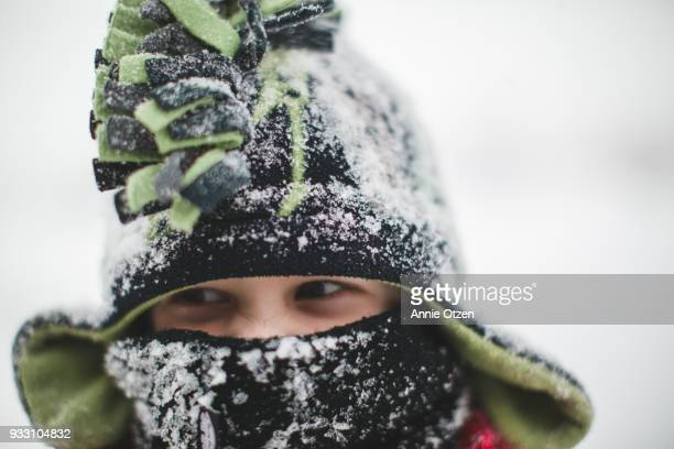 boy covered in snow - bundle stock pictures, royalty-free photos & images