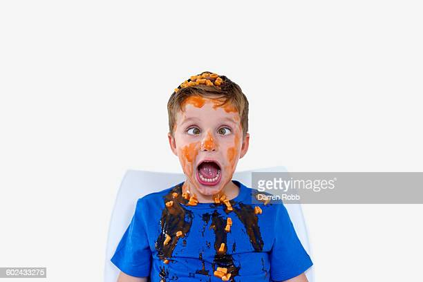 boy covered with alphabet spaghetti - ugly boys photos stock photos and pictures
