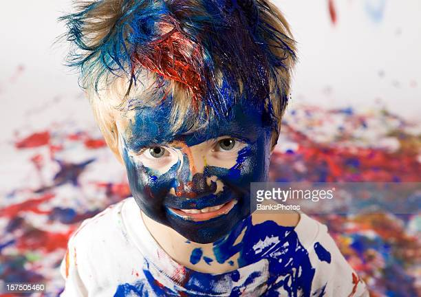 boy covered with paint - mischief stock pictures, royalty-free photos & images