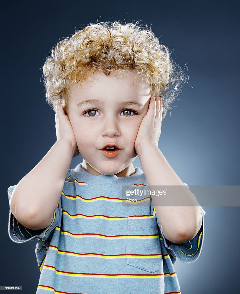 Boy (2-4) covering ears, close-up : Stock Photo