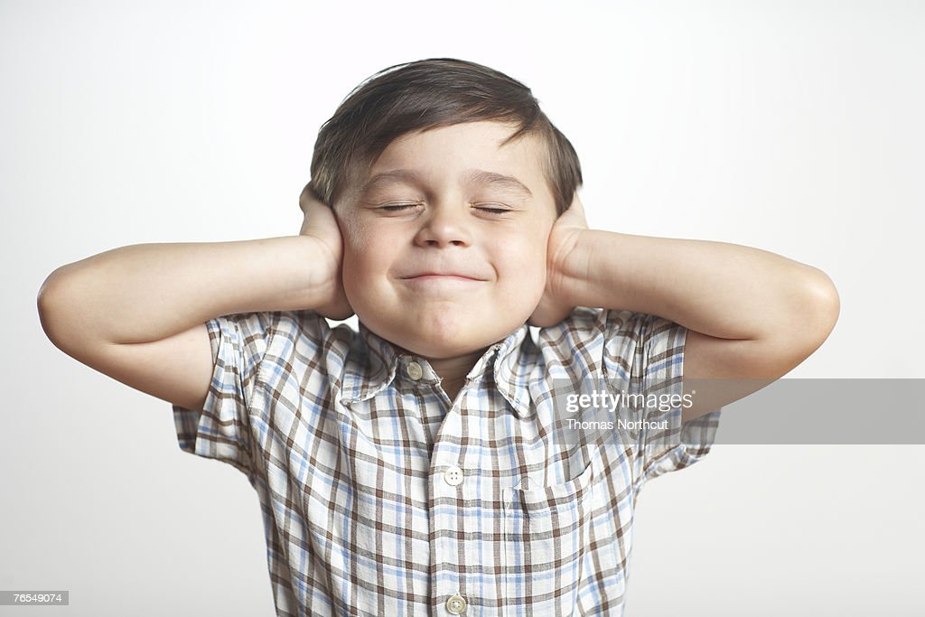 Boy (3-5) covering ears, eyes closed, close-up : Stock Photo