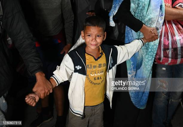 Boy cries as Honduran migrants heading to the border with Guatemala, march in the municipality of El Florido, in the Honduran department of Copan, on...